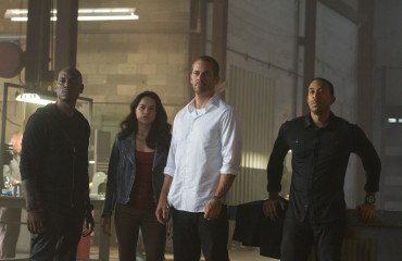 "(L to R) Roman (TYRESE GIBSON), Letty (MICHELLE RODRIGUEZ), Brian (PAUL WALKER) and Tej (CHRIS ""LUDACRIS"" BRIDGES). Photo Credit: Scott Garfield"