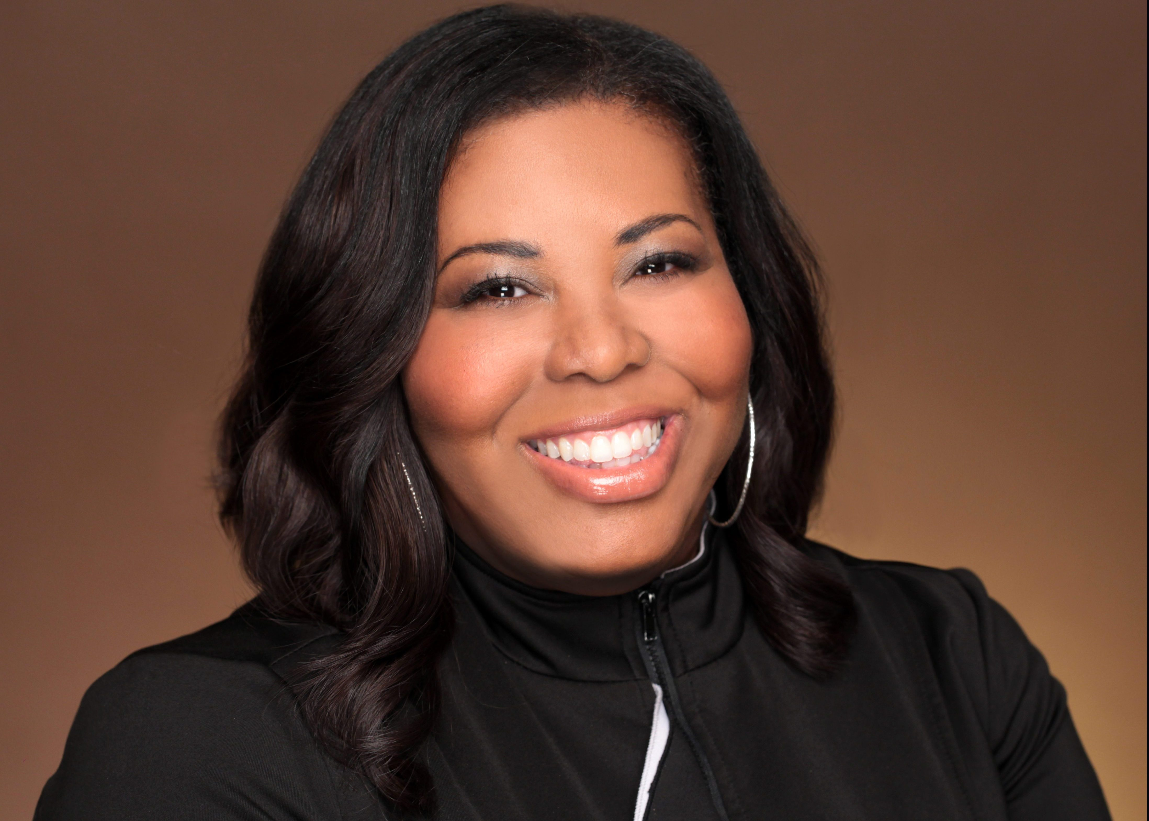 ESPN VP KIMBERLY WILSON'S UNCONVENTIONAL PROFESSIONAL JOURNEY AND SUCCESS PAVES WAY TOWARDS  PAYING IT FORWARD